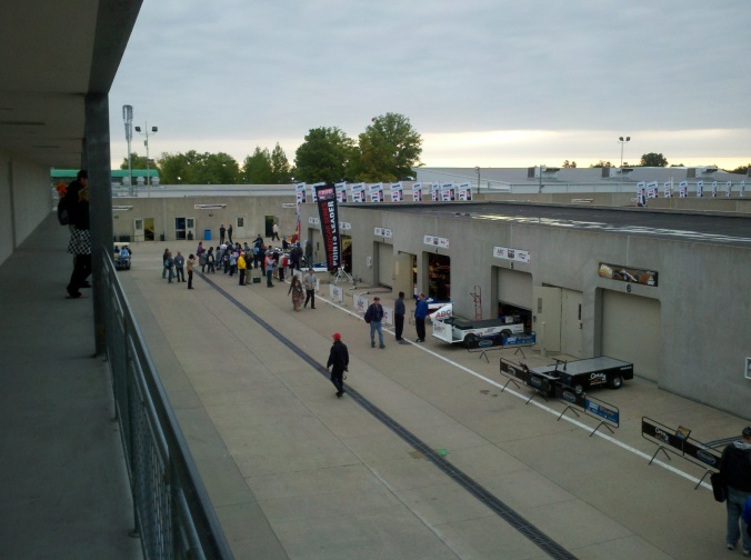 Crowd mulling about outside the garage of A.J. Foyt Racing